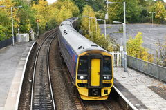 Train Arrives at a Station. TROWBRIDGE, UK - OCTOBER 18, 2015: A train arrives at the town's station. Opened in 1848 the station operates on the Wessex Main Line Stock Photo
