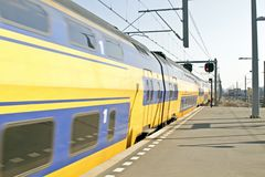 Train arriving in Amsterdam the Netherlands Stock Image
