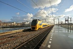 Train arriving in Amsterdam Netherlands Royalty Free Stock Photo
