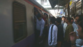 Train arriving at the crowded train station in Mumbai. MUMBAI, INDIA - 9 JANUARY 2015: Train arriving at the crowded train station in Mumbai stock footage