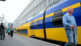 Train arriving, Haarlem railway station, Netherlan. HAARLEM - SEP 10: train arriving to the Haarlem railway station on September 10, 2014 in Haarlem, Netherlands stock video footage