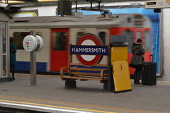 Train arriving Hammersmith station platform Royalty Free Stock Photography