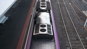 Train arriving at a railway station. High angle shot of a train arriving at a railway station stock footage