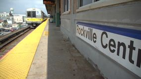 Train arriving at the Rockville Centre station stock footage