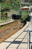 Train arriving at rural Japanese station. Stock Images