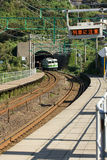 Train arriving at rural Japanese station. Royalty Free Stock Photography