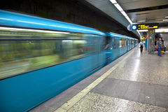 Train arriving in the station. Blue Train arriving in the station Royalty Free Stock Image