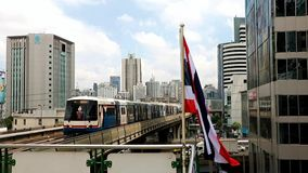 Train arriving at the station. With a waving flag of Thailand stock footage