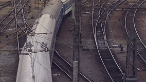 Train Arriving to Station Aerial Top View. Of Intersecting Rails at Train Railway Station stock video