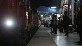 Train arriving at the train station in the night time in Mumbai. MUMBAI, INDIA - 12 JANUARY 2015: Train arriving at the train station in the night time in stock footage