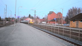 Train arriving in Vammala station, Finland stock video