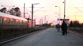 Train arriving in Vammala station, Finland stock video footage