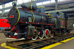 Train as means of transportation. Renovated old locomotive in the factory,photography Stock Images