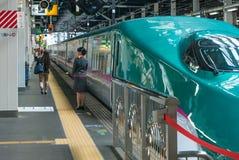 Train attendant of E5 Series train gran class. Royalty Free Stock Image