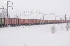 The train is available in winter. Wagons on the snow-covered road. Railway in winter. stock photos