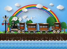 Train on a background of rainbow. Royalty Free Stock Photo