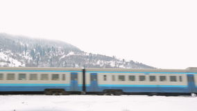 Train on the background of winter mountains stock footage