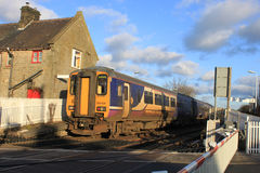 Train at Bare Lane level crossing and station Royalty Free Stock Photography