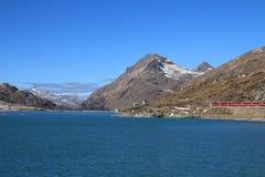 Train on the Bernina pass and turquoise Lake Blanc Stock Photography