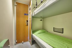 Train berth indoor with two beds. Travel background. Royalty Free Stock Photography
