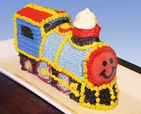 Train birthday cake. Highly decorated train locomotive cake for a toddler's birthday (with clipping path royalty free stock photo