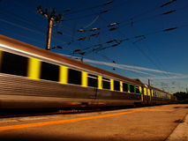 Train on blur mouvement in bright day Royalty Free Stock Image