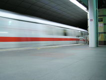 Train blurred by speed. Taken in singapore, a very reliable form of transport in singapore, midnight Stock Photo