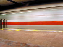 Train blurred by speed. Taken in Singapore, a very reliable form of transport. Train is blurred by motion Royalty Free Stock Images