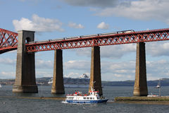 Train and boats with Forth Rail Bridge, Scotland. Royalty Free Stock Photo