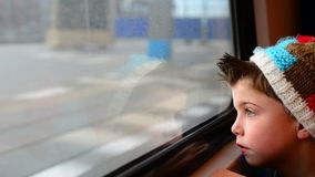 Train boy. Boy in a moving train with his reflection in the window stock video footage