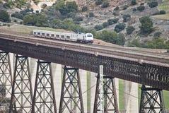 Train on bridge. Moving train on a bridge Stock Photos