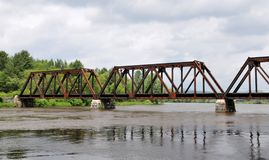 Train Bridge. Over the Connecticut River on the New Hampshire/Vermont border on an overcast day royalty free stock image