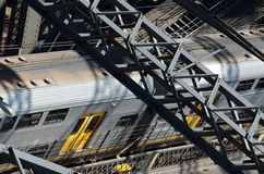 Train on bridge. Grey and yellow public train running on metallic bridge (Sydney Harbour Bridge) for commuters Royalty Free Stock Photos