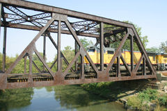 Train Bridge. A Train crossing over and old rusty bridge Royalty Free Stock Photo