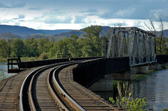 Train Bridge. Train tracks over a train bridge over a river royalty free stock photos