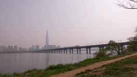 Train on Bridge across Hun River, Seoul panorama, Sauth Korea