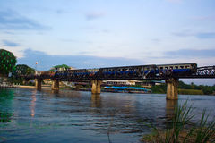 Train on the bridge across the river. Stock Photos