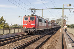 Train on the bridge in Cologne, Germany Stock Photo
