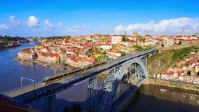 Train on bridge. A train on Dom Luis I Bridge in Porto with downtown at background, Portugal stock video