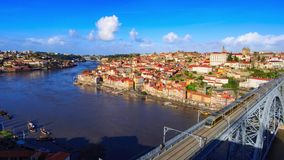 Train on bridge. A train on Dom Luis I Bridge in Porto with downtown at background, Portugal stock video footage