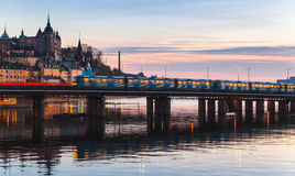 Train on bridge of Gamla Stan, Stockholm. Evening cityscape with Metro train on the bridge of Gamla Stan, Stockholm, Sweden Royalty Free Stock Photography
