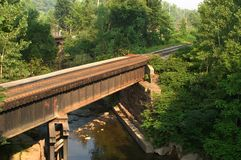 Train Bridge Horizontal. Horizontal view of a train bridge crossing a small river Stock Photos