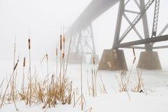 Train Bridge Lost in Fog. Marsh in the foreground with train bridge lost in the fog Stock Images