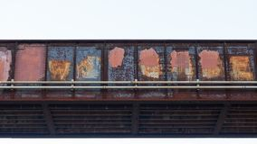 Train bridge made of iron red with rust and covered in paint covering up graffiti stock photo