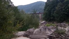 Train on the bridge in the mountains stock video footage