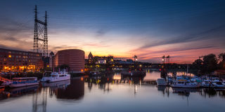 Train Bridge Over Harbor at Sunset Stock Photos