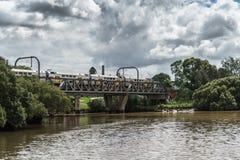 Train bridge over Parrmatta River, Parramatta Australia. Parramatta, Australia - March 24, 2017: Train rides over train bridge crossing the Parramatta River Stock Photo