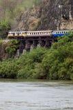 Train on Bridge over River Stock Photography