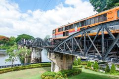 Train on the bridge over river Kwai in Kanchanaburi province, Thailand.The bridge is famous. Kanchanaburi, Thailand - May 23, 2014: Train on the bridge over Royalty Free Stock Images