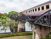Train on the bridge over river Kwai in Kanchanaburi province, Thailand.The bridge is famous. Kanchanaburi, Thailand - May 23, 2014: Train on the bridge over Royalty Free Stock Photos